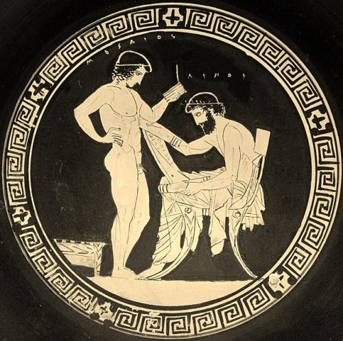 Lino, sentado, con un rollo de pergamino, y su discípulo Museo, con unas tablillas de escribir (Museo del Louvre)